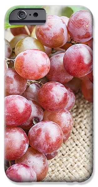Table Wine iPhone Cases - Red grape with green leaves on natural sackcloth iPhone Case by Rakop Tanyakam