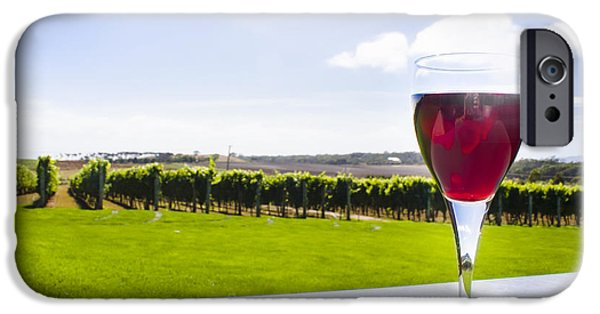 Table Wine iPhone Cases - Red wine glass at Tasmania countryside winery iPhone Case by Ryan Jorgensen