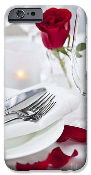 Table Wine iPhone Cases - Romantic dinner setting with rose petals iPhone Case by Elena Elisseeva