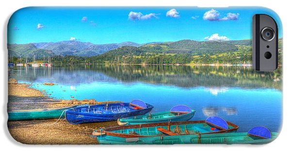 Pleasure iPhone Cases - Rowing boats on calm still lake with mountains and blue sky in summer iPhone Case by Michael Charles