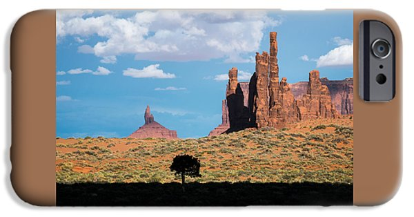 United iPhone Cases - Silhouetted Tree at Monument Valley iPhone Case by Mary Lee Dereske