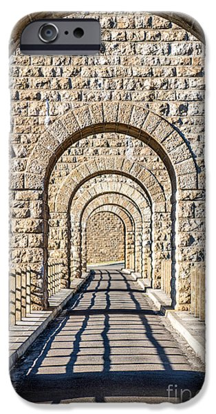 Asphalt iPhone Cases - Stone arch in a row in selective focus iPhone Case by Gregory DUBUS