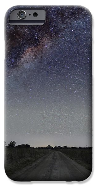 The Milky Way Galaxy Over A Rural Road iPhone Case by Luis Argerich