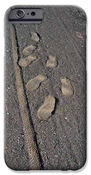 Prescott iPhone Cases - Tire Tracks and Foot Prints iPhone Case by Heather Kirk