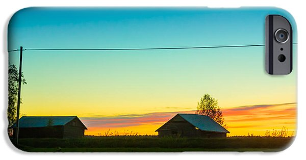 Mist iPhone Cases - Two Barn Houses In The Springtime Sunset iPhone Case by Jukka Heinovirta