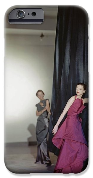 Ball Gown Photographs iPhone Cases - Two Models Wearing Evening Dresses iPhone Case by Conde Nast
