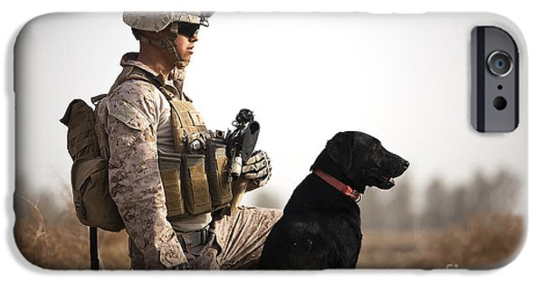 Bonding iPhone Cases - U.s. Marine Holds Security In A Field iPhone Case by Stocktrek Images