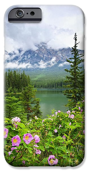 Alberta iPhone Cases - Wild roses and mountain lake in Jasper National Park iPhone Case by Elena Elisseeva