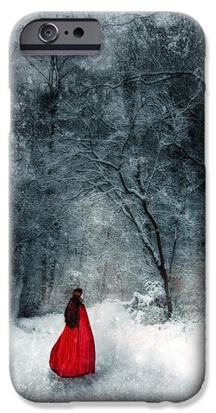 Wintertime iPhone Cases - Woman in Red Cape Walking in Snowy Woods iPhone Case by Jill Battaglia