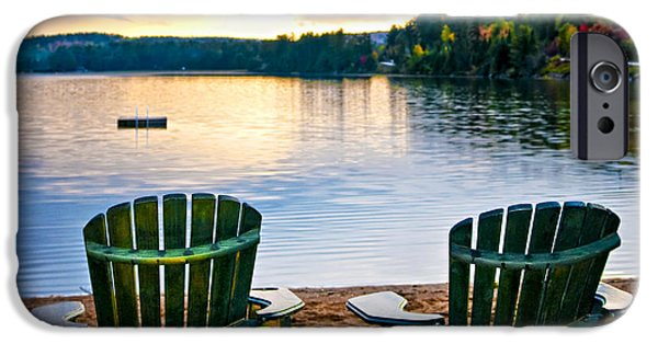 Algonquin iPhone Cases - Wooden chairs at sunset on beach iPhone Case by Elena Elisseeva
