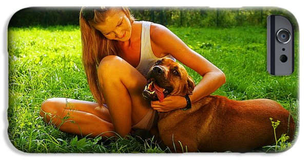 Mastif iPhone Cases - Young Beautiful Woman With Blonde Hair Is Playing With A Mastif Dog In A Backyard With Green Grass iPhone Case by Jozef Klopacka