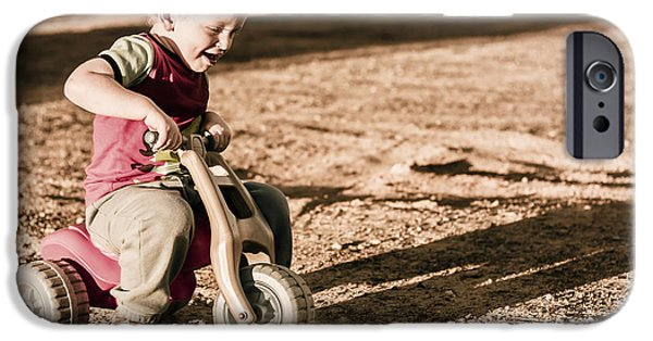 Break Fast iPhone Cases - Young boy breaking at fast pace on toy bike iPhone Case by Ryan Jorgensen