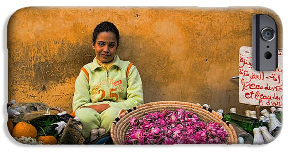 Young iPhone Cases - Young girl selling rose petals in the Medina of Fes Morroco iPhone Case by David Smith