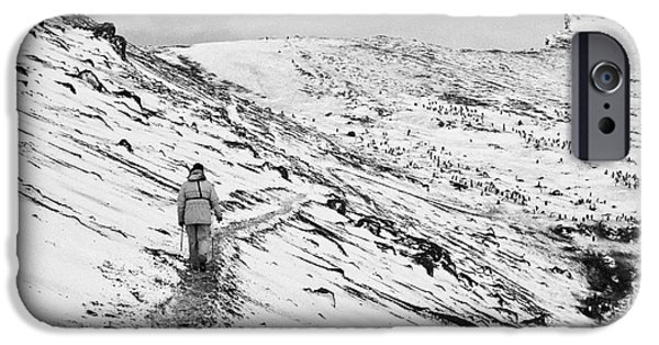 two tourists walking along ridge at hannah point penguin colony Antarctica IPhone Case by Joe Fox
