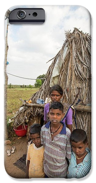 An Untouchable Family Outside Their Hut IPhone Case by Ashley Cooper
