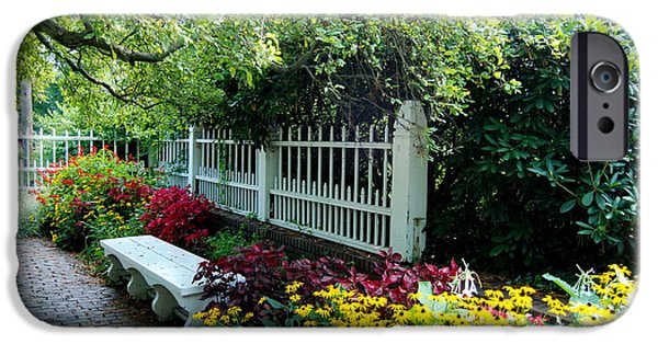 Pretty Park Bench Sits Within The Lovely Prescott Park Area Of Portsmouth New Hampshire IPhone Case by Eunice Miller