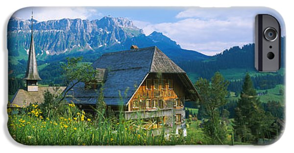 Chalet And A Church On A Landscape IPhone Case by Panoramic Images