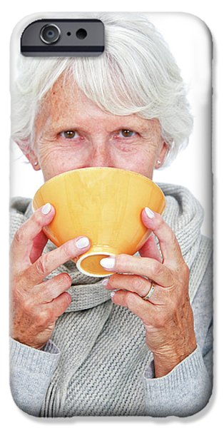 Elderly Woman With A Hot Drink IPhone Case by Lea Paterson