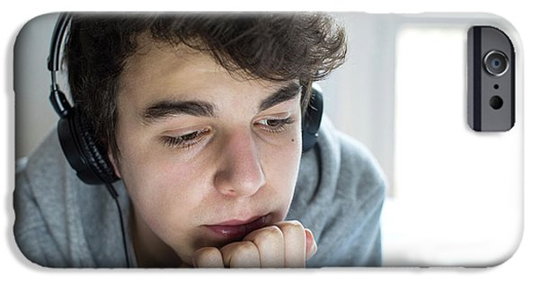 Young Man Wearing Headphones IPhone Case by Mauro Fermariello