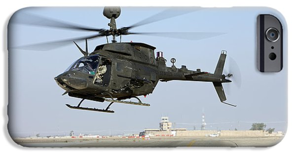 An Oh-58d Kiowa Warrior Hovers IPhone Case by Terry Moore