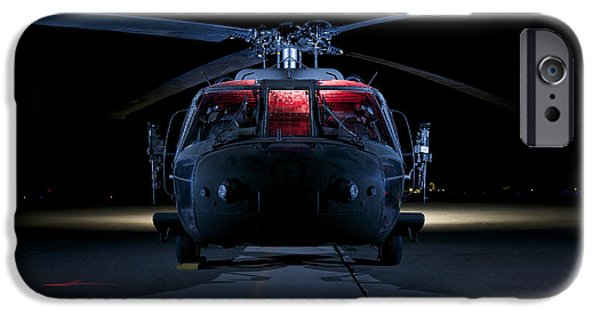 A Uh-60 Black Hawk Helicopter Lit IPhone Case by Terry Moore