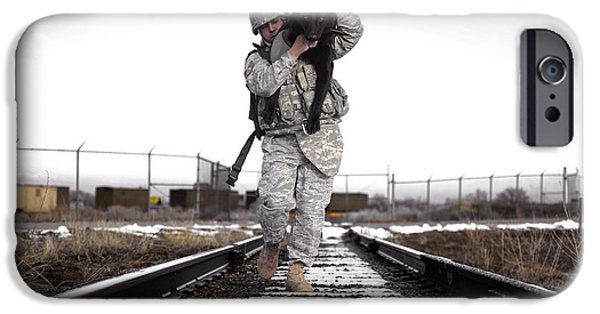 A Military Dog Handler Uses An IPhone Case by Stocktrek Images