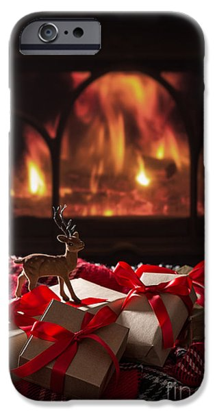 Christmas Gifts By The Fireplace IPhone Case by Amanda And Christopher Elwell