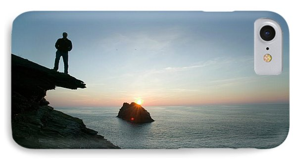 A Man On The Cliff Tops At Boscastle IPhone Case by Ashley Cooper