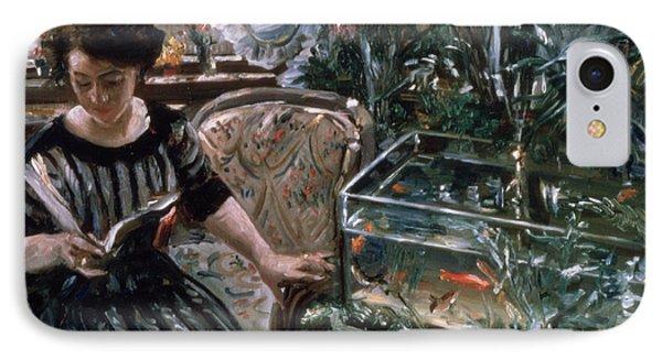 A Woman Reading Near A Goldfish Tank IPhone Case by Lovis Corinth
