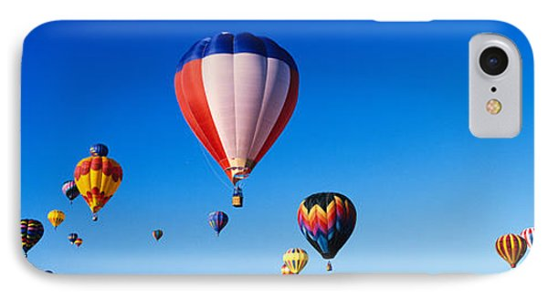 Balloons Floating In Blue Sky IPhone Case by Panoramic Images