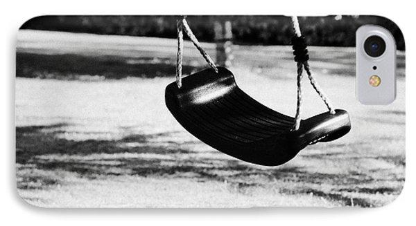 Empty Plastic Swing Swinging In A Garden In The Evening IPhone Case by Joe Fox