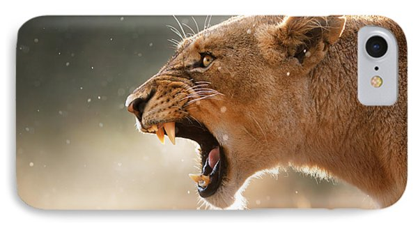 Lioness Displaying Dangerous Teeth In A Rainstorm IPhone Case by Johan Swanepoel