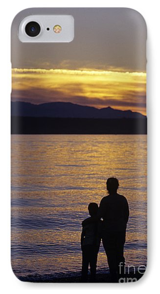 Mother And Daughter Holding Each Other Along Edmonds Beach At Su Phone Case by Jim Corwin
