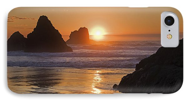 Orange Sunset Behind Offshore Rocks Phone Case by Philippe Widling