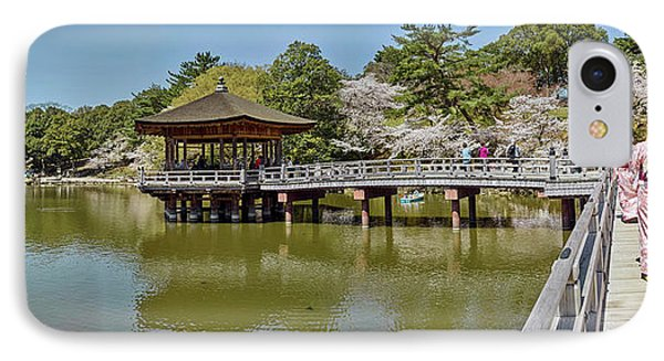 People Walking On Bridge Over A Pond IPhone Case by Panoramic Images