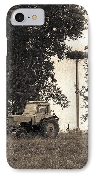 Stork Vs Tractor Phone Case by Yevgeni Kacnelson