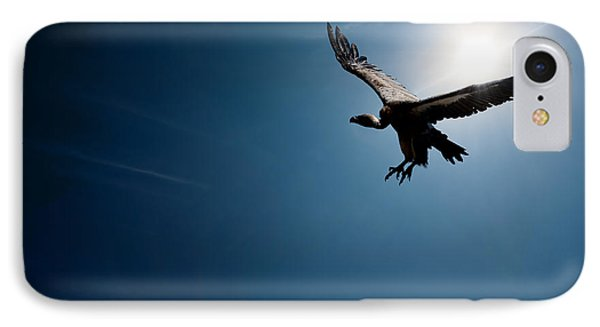 Vulture Flying In Front Of The Sun IPhone Case by Johan Swanepoel
