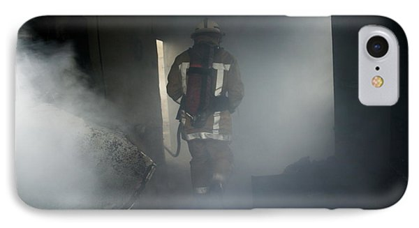 Fire Fighter In A Burnt House Phone Case by Michael Donne