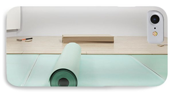 Laying A Floor. A Roll Of Underlay Or IPhone Case by Magomed Magomedagaev