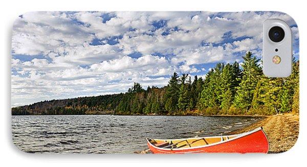Red Canoe On Lake Shore IPhone Case by Elena Elisseeva