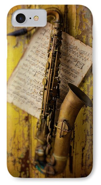 Saxophone Hanging On Old Wall IPhone Case by Garry Gay