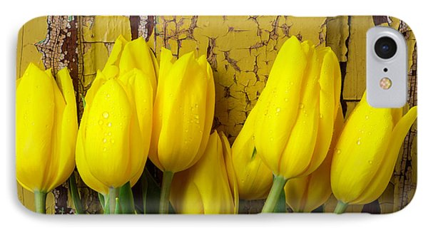Tulips Leaning Against Yellow Wall IPhone Case by Garry Gay