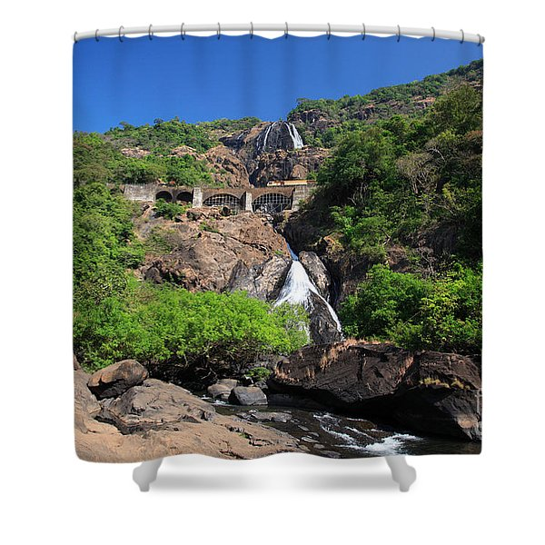 Train Crossing Dudhsagar Falls Shower Curtain by Deborah Benbrook