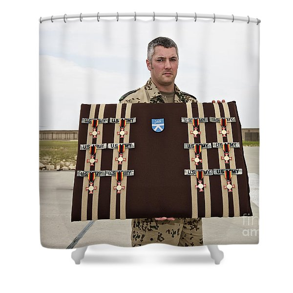 A German Soldier Holds A Display Shower Curtain by Terry Moore