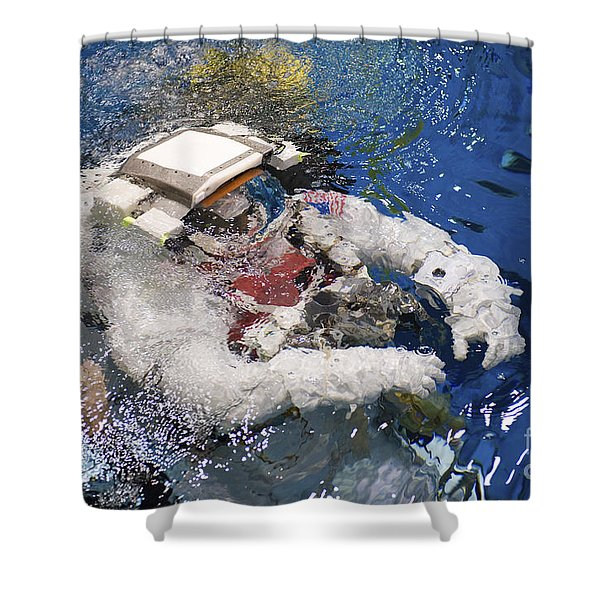 An Astronaut Is Submerged In The Water Shower Curtain by Stocktrek Images