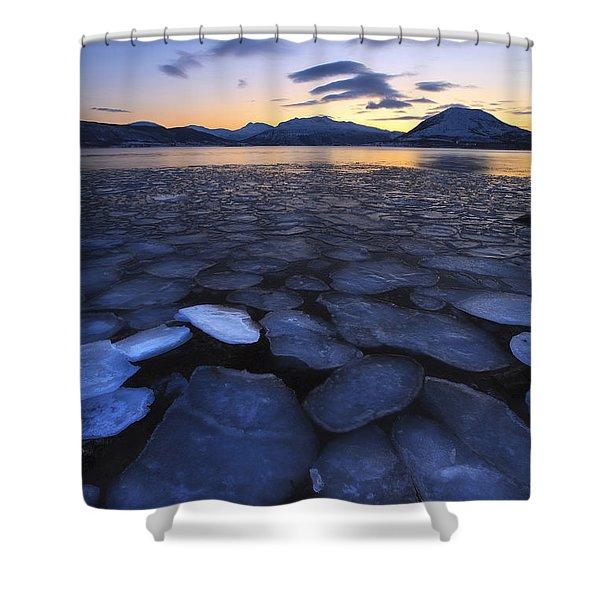 Ice Flakes Drifting Towards Shower Curtain by Arild Heitmann