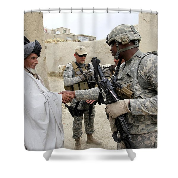 U.s. Army Soldier Shakes Hands With An Shower Curtain by Stocktrek Images