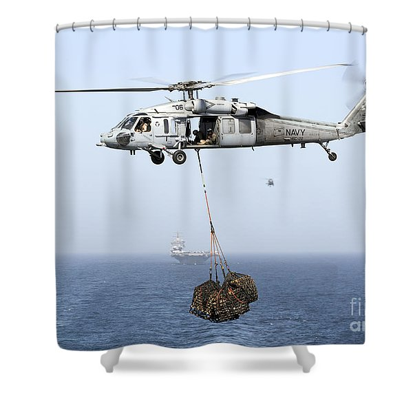 A Mh-60 Helicopter Transfers Cargo Shower Curtain by Gert Kromhout