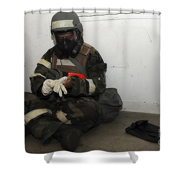 Airman Dons His Chemical Warfare Shower Curtain by Stocktrek Images