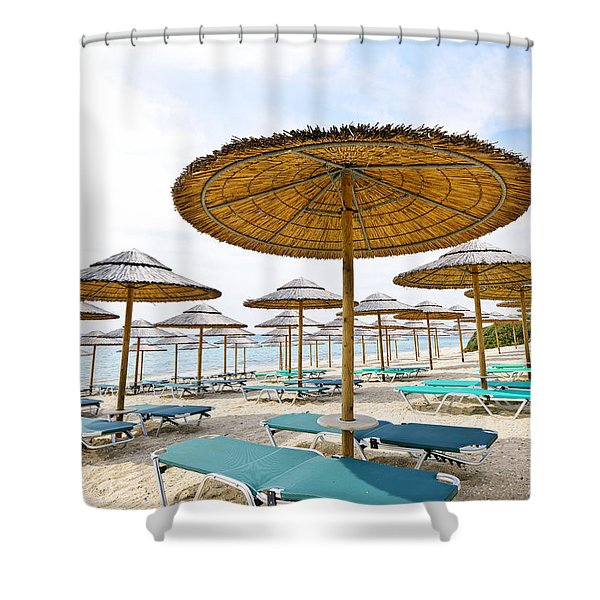 Beach umbrellas and chairs on sandy seashore Shower Curtain by Elena Elisseeva